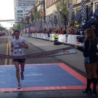 Craig Leon as he wins the half marathon